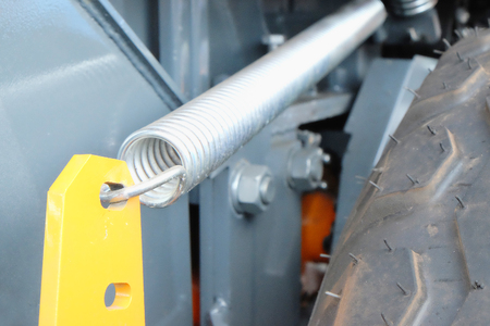 annealed: fragment of a spring mechanism in the agricultural equipment Stock Photo