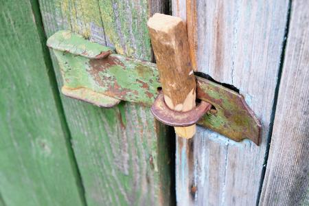 door bolt: old bolt on a wooden door