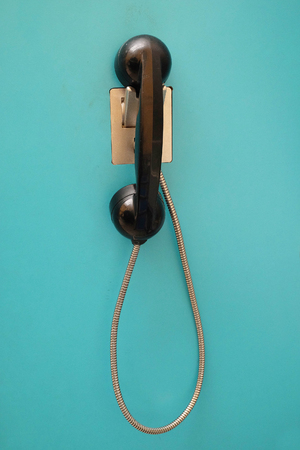 receiver: vintage telephone receiver on the wall