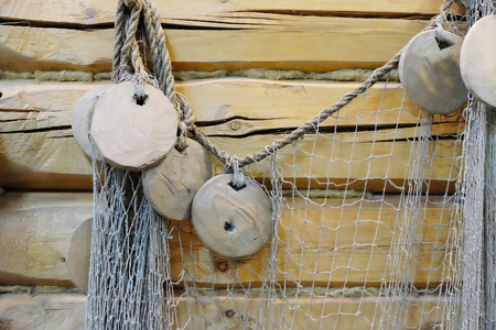 old net on the wall of the hut