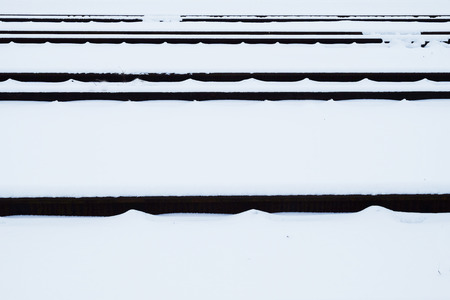 railway tracks covered with snow Stock Photo