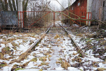 abandoned railway entrance to a secure enterprise Stock Photo