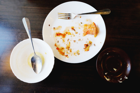 dirty and empty plates on the table in the restaurant Stock Photo