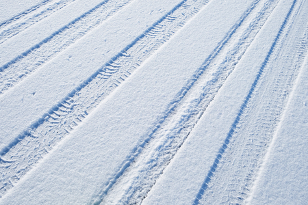 winter tires: traces of cars on the freshly fallen snow