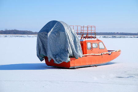 hovercraft: boat with a propeller on the ice of the Bay