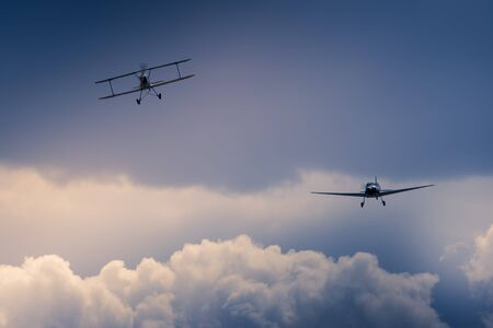 Airplanes in stormy sky at Melun villaroche airshow