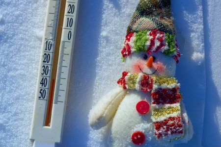 thermometer and snowman in the snow on a cold day Stock Photo