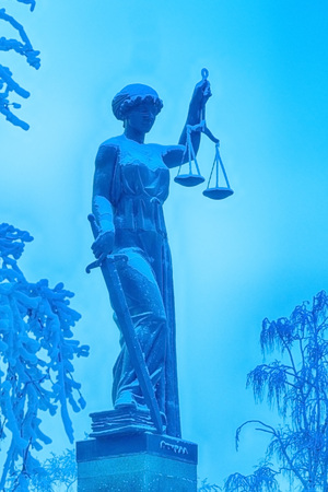a statue of Justice, the focus is on scales Stock Photo