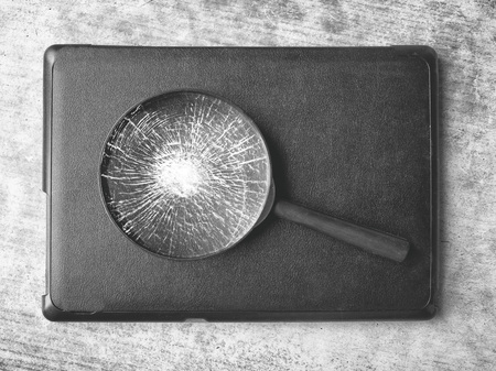 magnifying glass with broken glass top view