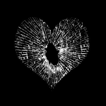 broken glass in the shape of heart on black background.