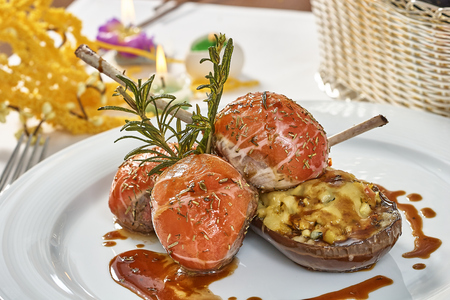 Image of lamb chops on a bed of vegetables Eggplant stuffed with vegetables Stock Photo