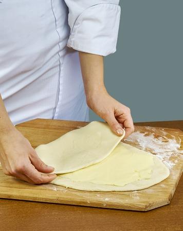 Woman rolls squeezes dough Handmade Series Food recipes Reklamní fotografie