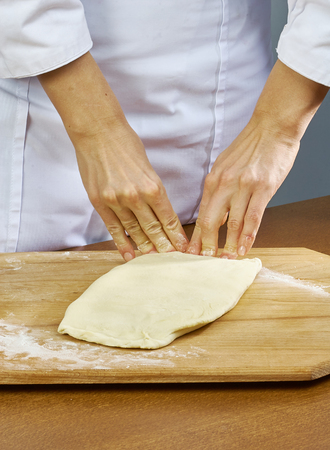 Woman rolls squeezes dough Handmade Series Food recipes Stock Photo