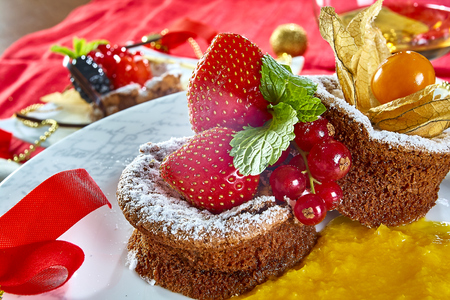 Cupcake with fresh fresh berries decoration on the table