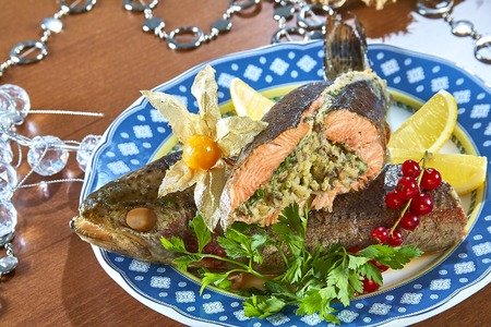 Fried stuffed fish on a platter festive menu Complete collection of recipes