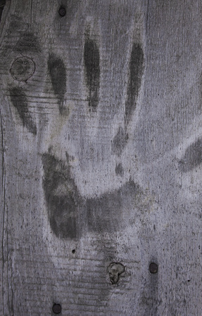 rusty nail: Handprint on a wooden surface
