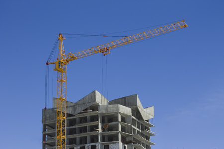 baffle: Tower crane and reinforced building Stock Photo