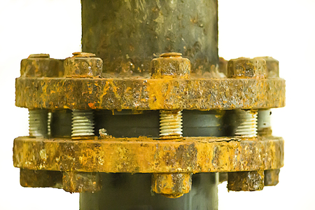 The flanges of valves with bolts and nuts corrosion isolated.
