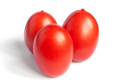 Three red tomato standing vertically with drop shadow on a white background Stock Photo