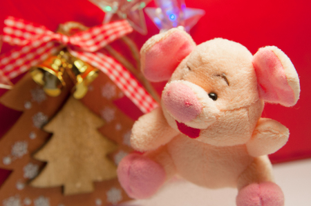 Handmade toy christmas tree and soft toy pink pig. Holidays concept.