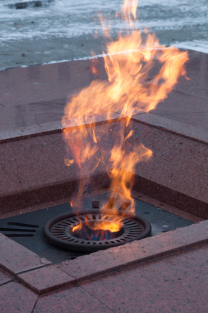 Eternal flame. Memory of fallen soldiers during World War Two. Flame tongues rising up.