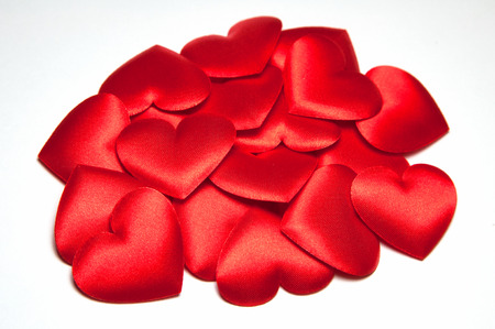 Many bright red silk small decorative hearts. A hill of decorative hearts Valentines day or Wedding.
