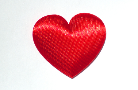Decorative red silk  heart. Love  and Valentines day concept.