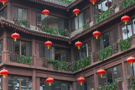 Part of  traditional Chinese Building with Lanterns and artificial flowers on the balconies. Chinese building in the center or the Xi'an, China