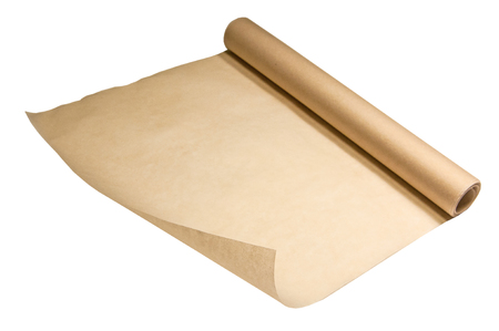 Roll of baking parchment paper for baking in the oven. One corner of the paper closest to the viewer is raised. Paper roll untwisted.