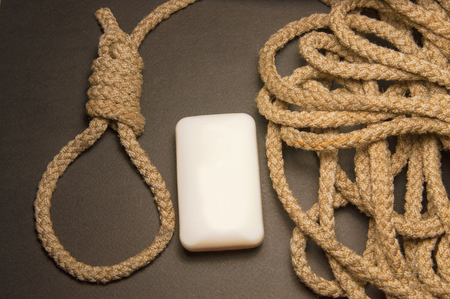 Rope with loop and white soap on black background. Rope With Hangmans Noose. Suicide concept