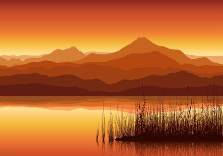 Puesta de sol en enormes montañas cerca de lake con césped