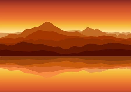 Puesta de sol en enormes montañas cerca de lago