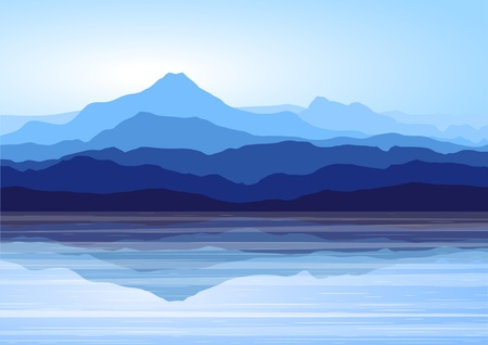 Vista sulle montagne blu con la riflessione nel lago