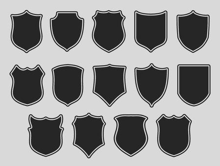 zbraně: Sada štítů s konturami na šedém pozadí. Vektorové ilustrace. Ilustrace