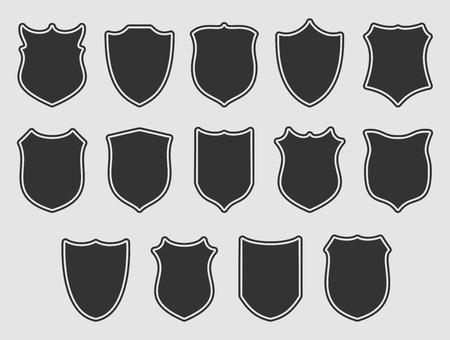 灰色の背景の上の輪郭をもつ盾の大規模なセット。ベクトルの図。