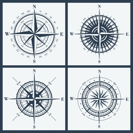 Set of isolated compass roses or windroses . Vector illustration.