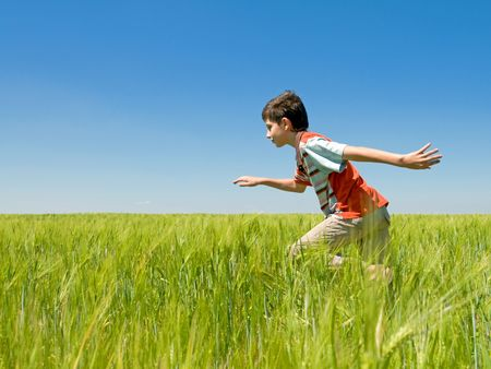 a boy is running in the field Stock Photo - 5229717