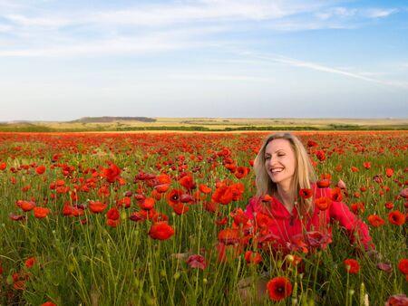 woman in the poppy field photo