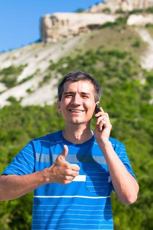 succesful: succesful man in the mountains