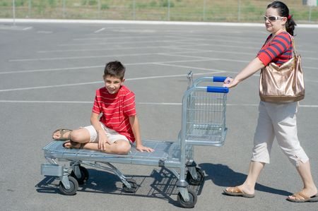 a mom and son are going for a weekend shopping Stock Photo - 5441344