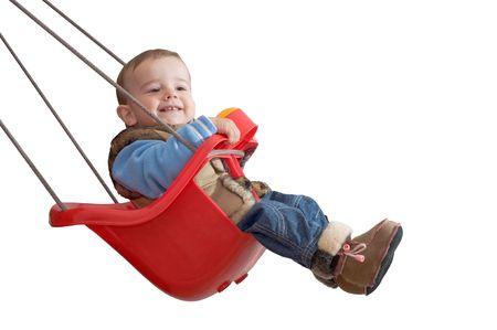 columpio: un beb� est� jugando en un columpio, aislados