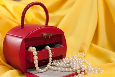 jewel case: A red case with jewels is on the yellow background Stock Photo