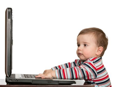 computering: A toddler is working with a laptop, isolated on white Stock Photo