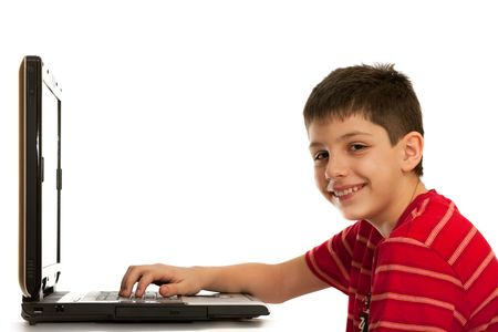 informational: A boy is sitting at the laptop smiling; isolated on the white background Stock Photo