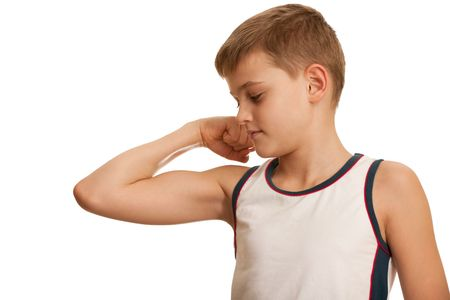 phisical: A kid is checking his muscules growth while doing his morning exercises; isolated on the white background