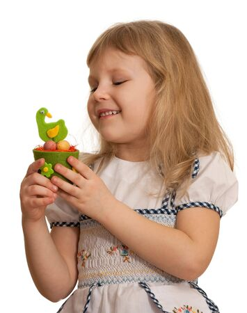 A pretty girl is holding an Easter toy; isolated on the white background photo