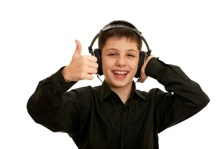 all right: A very happy boy with headphones is showing his tumb up; isolated on the white background