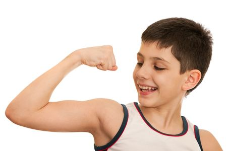 A boy is showing his arm muscules; isolated on the white background photo