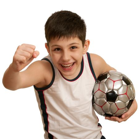 A running teen holding his right fist up and with a football ball in his left hand; isolated on the white background photo