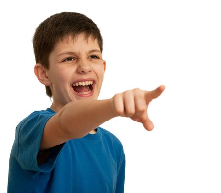 A yelling teen is pointing forward; isolated on the white background